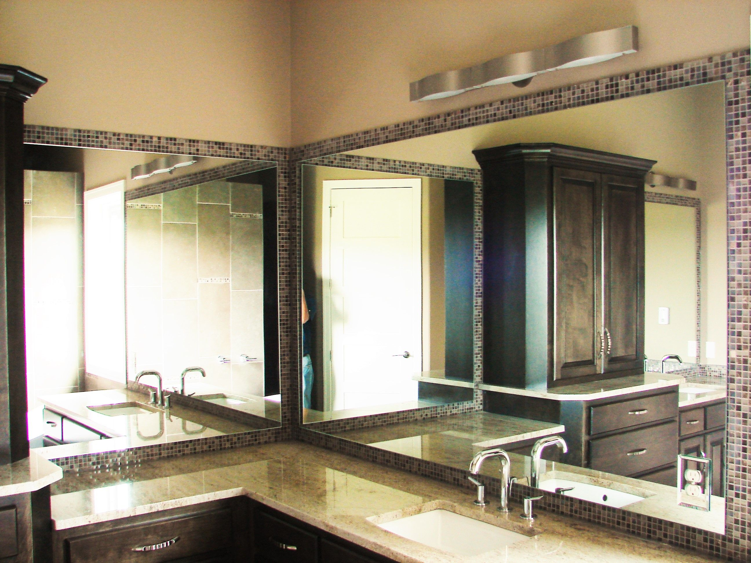 Two Part Mirror Stood Off From The Wall Over Mosaic Tile Endearing Bathroom Remodeling Omaha Decorating Design