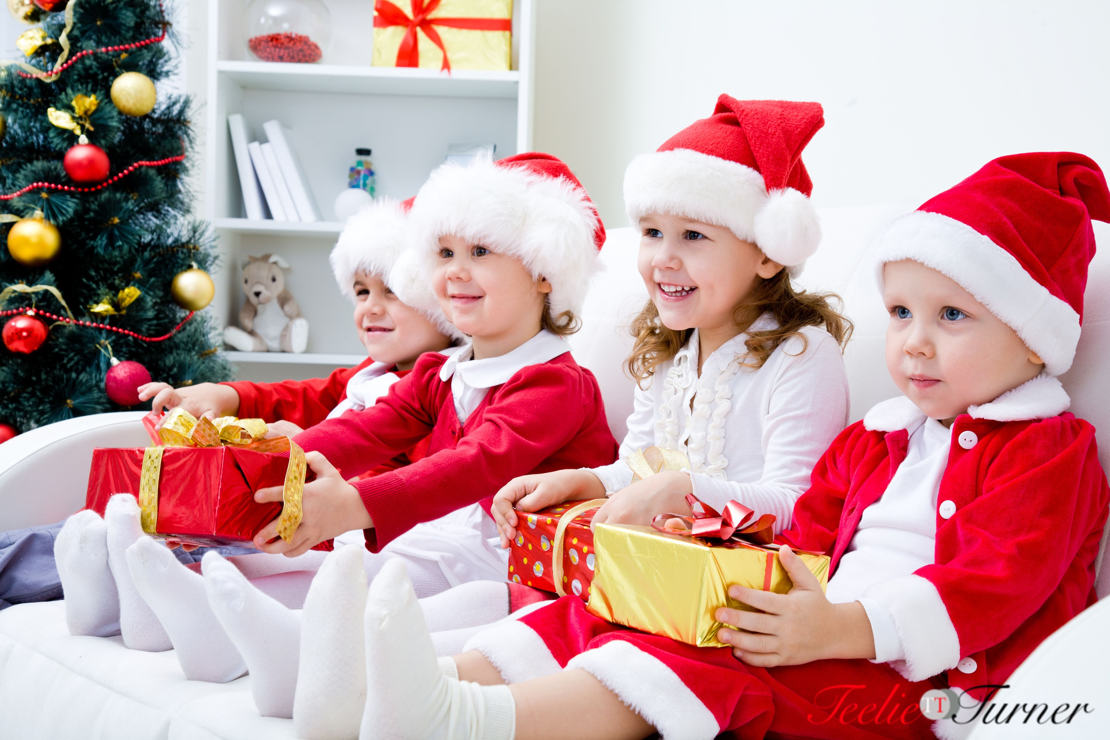 Happy little children preparing for Christmas wearing Santa costume. www.teelieturner.com #Christmas