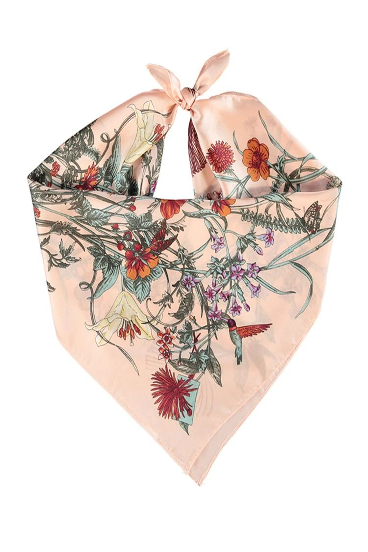A satin square scarf featuring a garden print with flowers, humming birds, and butterflies.