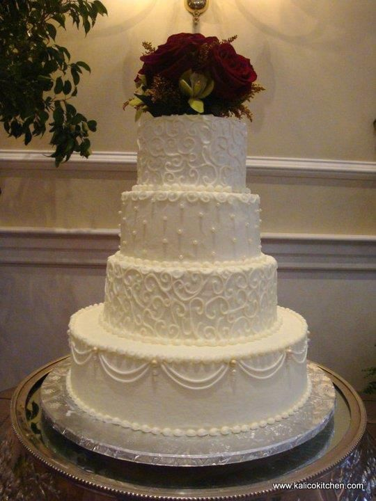 Wedding Cakes  4 Tier, Buttercream, White, Scroll Work, Sugar Pearls,  Draped Buttercream Piping