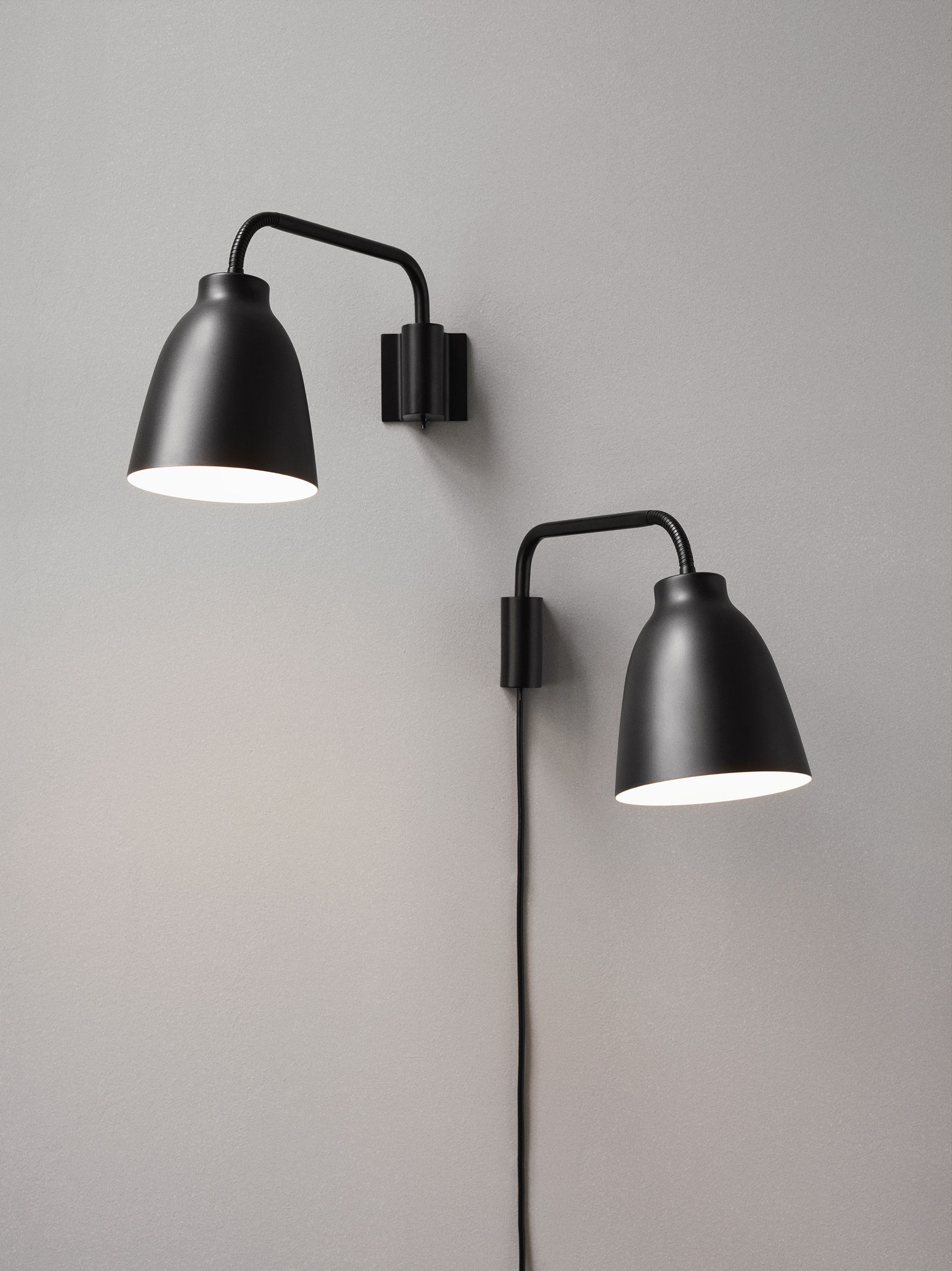 Zwarte caravaggio wandlamp ontworpen door cecilie manz en gemaakt the caravaggio wall lamp was designed by cecilie manz for lightyearse caravaggio wall lamp belongs to the collection of danish design lighting from aloadofball Image collections