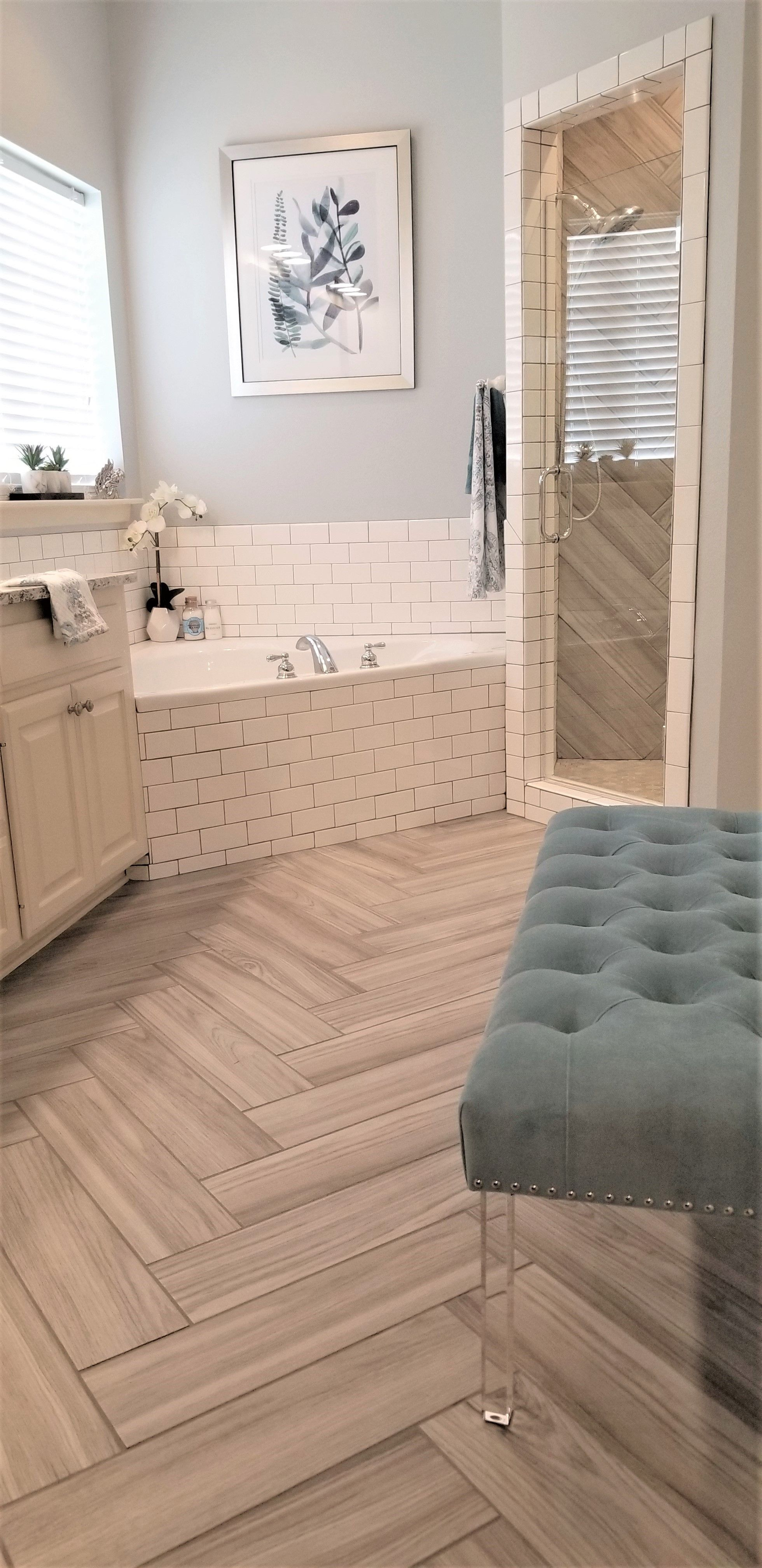 gray wood look tile laid in herringbone pattern compliments the