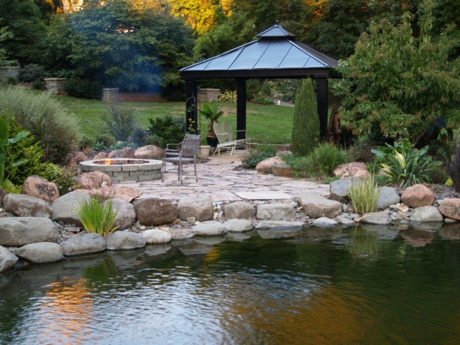 patio with fireplace and pond - Google Search