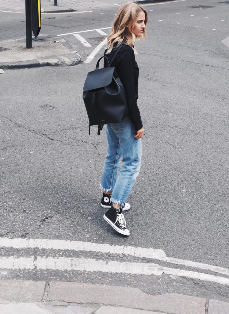 1346c8d27574 Ankle high converse look edgy and sleek when worn with ripped mom jeans and  a casual black shirt. Via Mirjam Flatau. Jeans  Levi