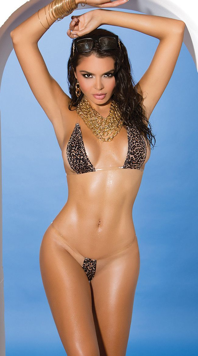 dc10596899 Look fiercely sexy in this leopard print bikini featuring small triangle  cups, clear halter straps, clear underbust straps with a tie back closure,  ...