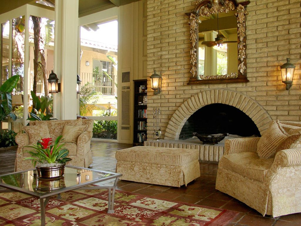 Mediterranean Style Interior Design Gallery of Luxury Beige Living Room  with Great White Brick Fireplace complete with the Wall Lamp and Beautiful  Flower ...