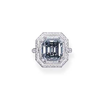 A DELICATE FANCY BLUE-GREY DIAMOND RING   The rectangular-cut diamond weighing 7.90 carats within a diamond two-row surround to the diamond hoop