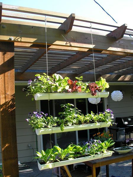 "DIY Hanging Gutter Garden is part of Vertical garden City - Short on garden space, but longing for your own veggie patch  What about this clever DIY project  Easily accomplished in a weekend, the planter boxes are made from recycled guttering  Rust patches for drain holes, a bit of potting mix and some seedlings and you can have an instant garden  And oh! This would also make a great divider in your yard to provide some privacy  Lettuce, herbs, strawberries or even some potted colour  The choice is yours  ) Materials 1 pc 8' PVC White Rain Gutter   cut to 3 32"" lengths 6 pcs PVC White Gutter End Caps"