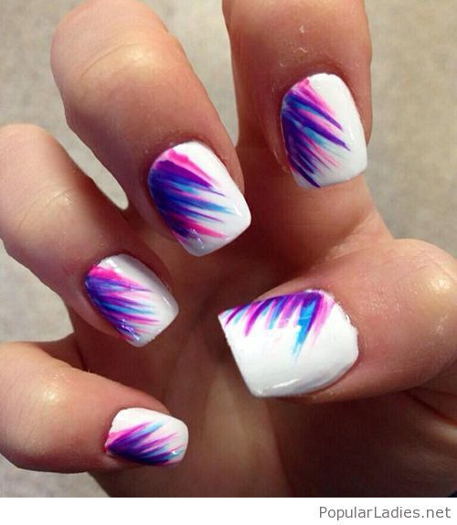 White nails with purple, pink and blue accents
