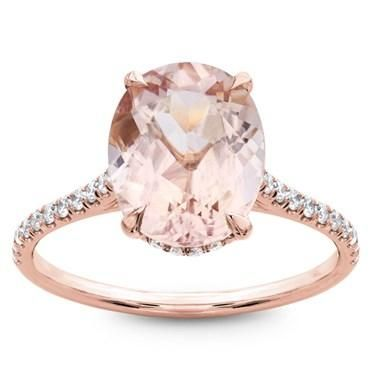 "This beautiful engagement ring is set with an 8-9mm oval cut Morganite. The thin band is 1.5mm wide with  0.25cttw of diamonds, in french cut pave'. Made for and featured on FYI's Marry Me Today Show, This ring is ""The One""."