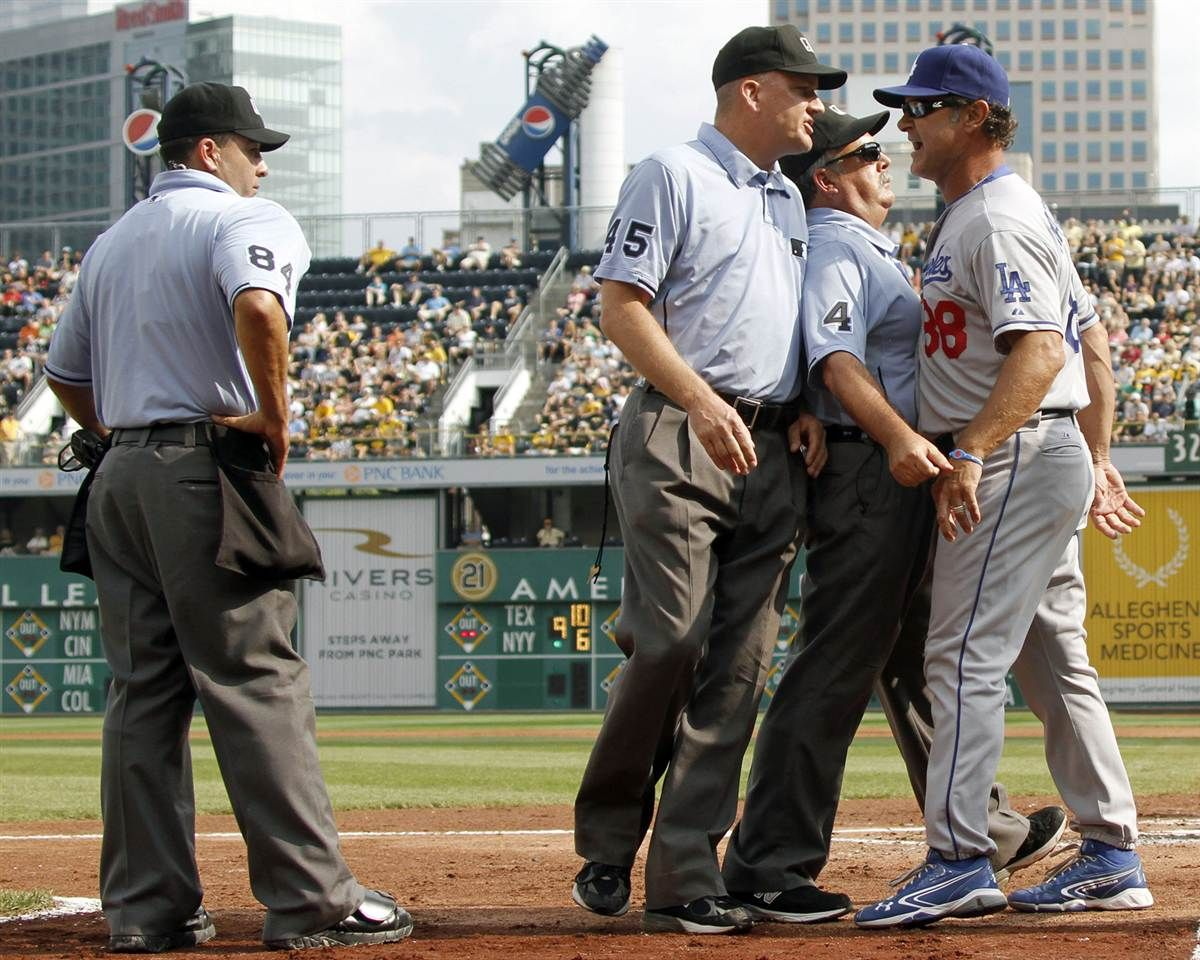 Baseball The American Pastime Umpires Tim Tschida 4 And Jeff Nelson 45 Get In Front Of Los Angeles Dodgers Don Mattingly Baseball Major League Baseball