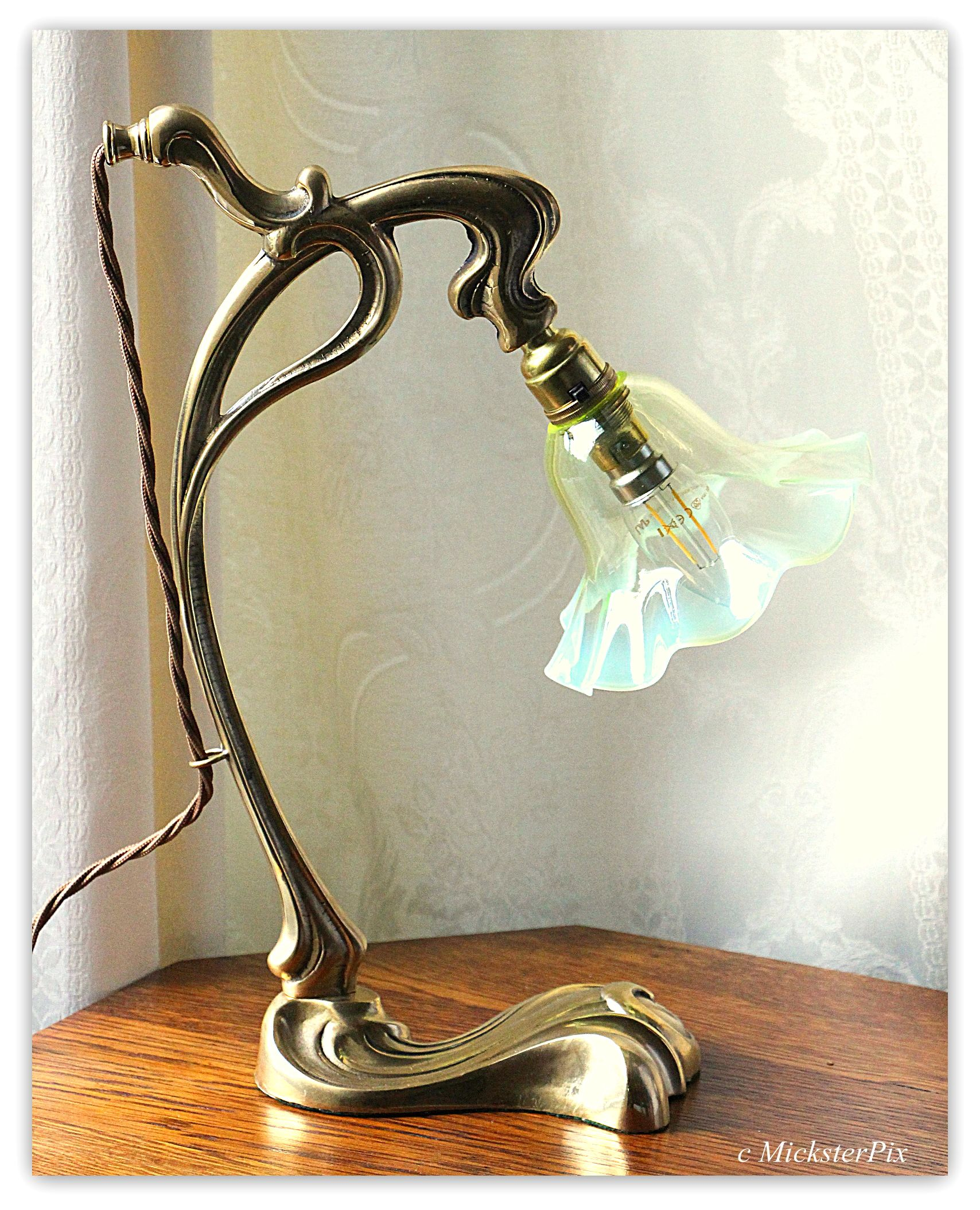 An Art Nouveau Brass Table Lamp With An