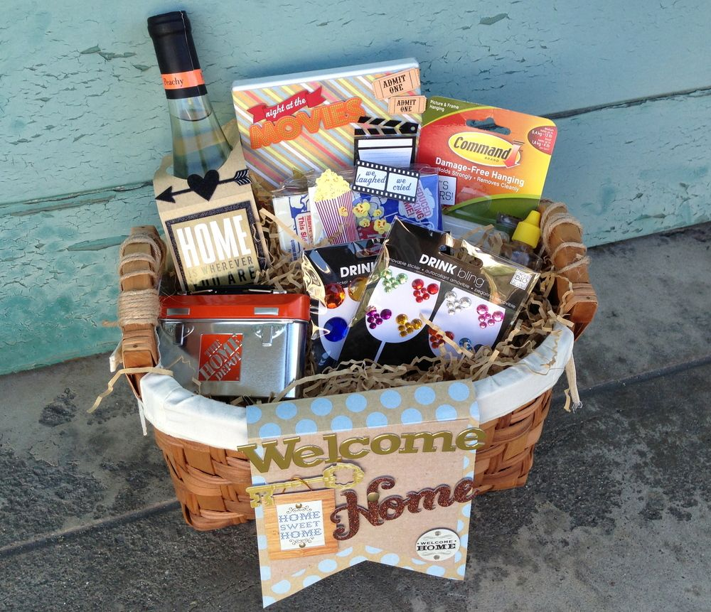 House Warming Goodie Basket is part of Welcome home Basket - Everyone loves a welcome home basket when they get to a new home  Something to make them feel welcomed  Gifts include in this awesome basket include fun stuff for a new homeowner  A movie, popcorn, bottle of wine, command strips, mambi drink bling, and a Hom