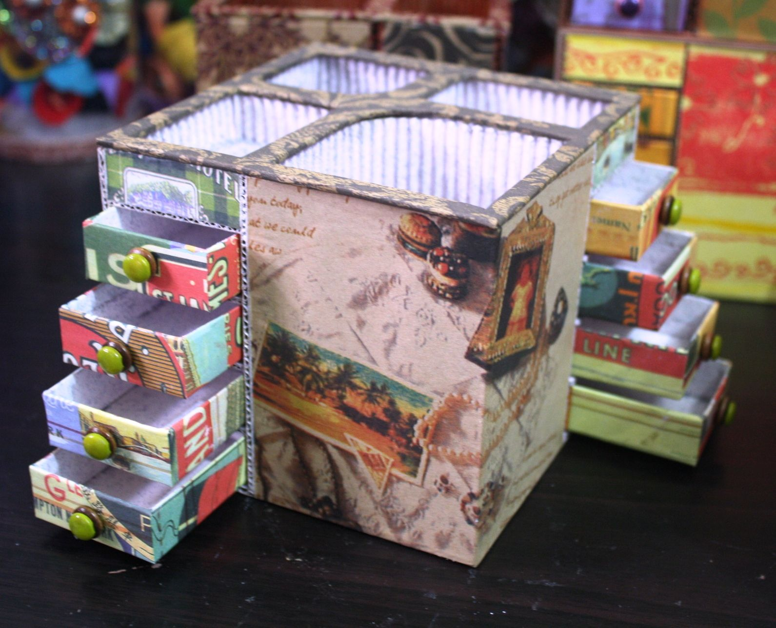 Penholder with matchbox drawers made from recycled corrugated boxes, cigarette boxes and gift wrapping papers.