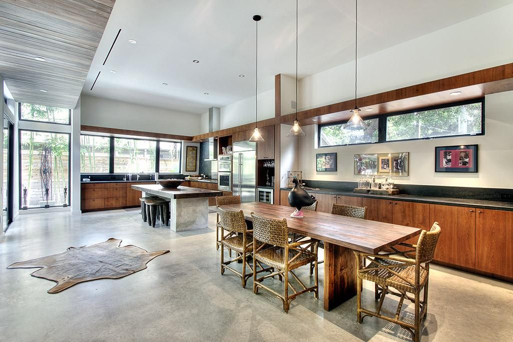 Formal Dining With 12 Ft Ceilings Pendent Lighting Concrete Floors Built In Cabinets For Serving With Etc Built In Cabinets Pendent Lighting Concrete Floors