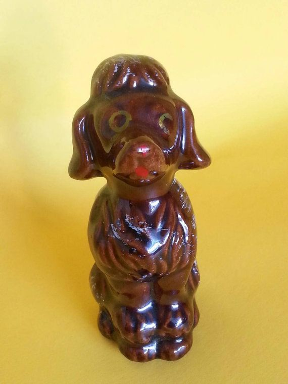 Check out this item in my Etsy shop https://www.etsy.com/listing/262285505/redware-poodle-figurine-1950s