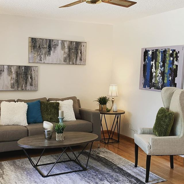 SENSATIONALLY STAGED for SALE! living room of a recent ...