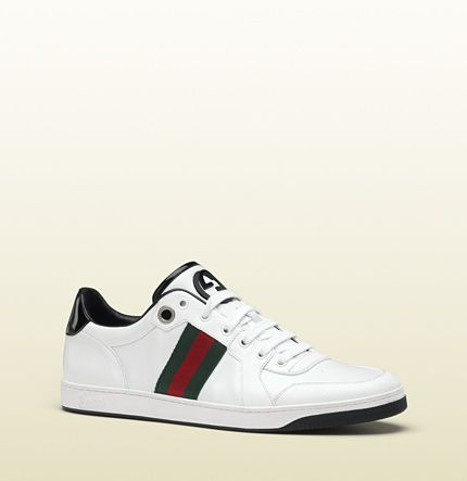 8725bf84f48e4 Gucci - lace-up sneaker with interlocking G and signature web detail.  283115APD909072