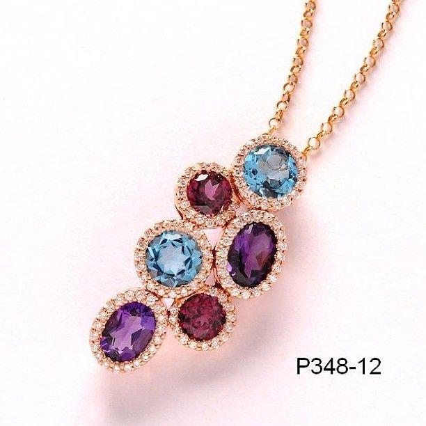 عقد الماس مع الاحجار شبه الكريمة من مجموعة ديلاكور Necklace Cross Necklace Pendant