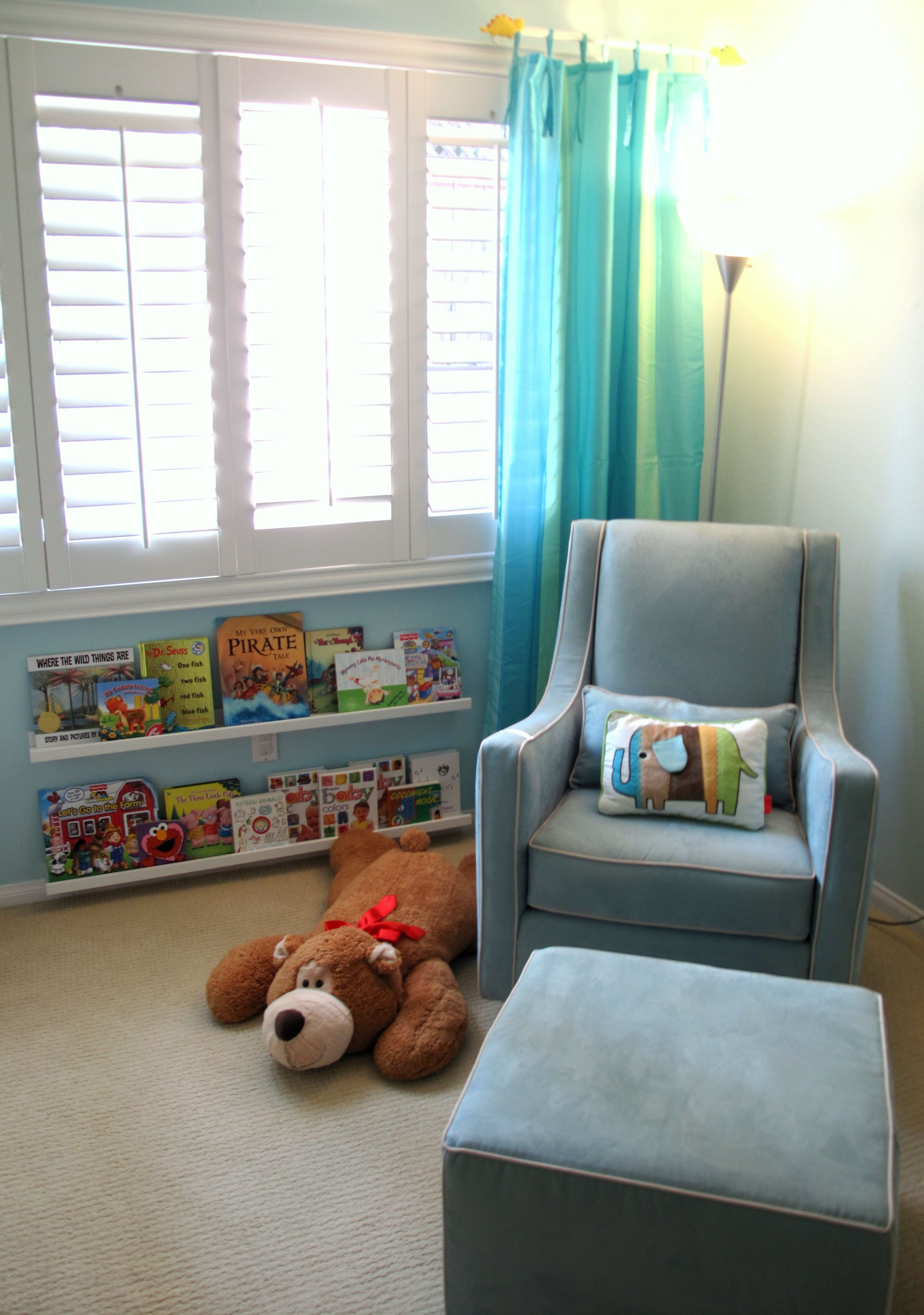 Use picture ledges under window or all along one wall for books...Ethan