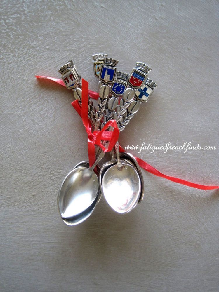 This is a lovely collection of 8 silverplate vintage French souvenir spoons from various destinations by Augis of Lyon Each spoon has the
