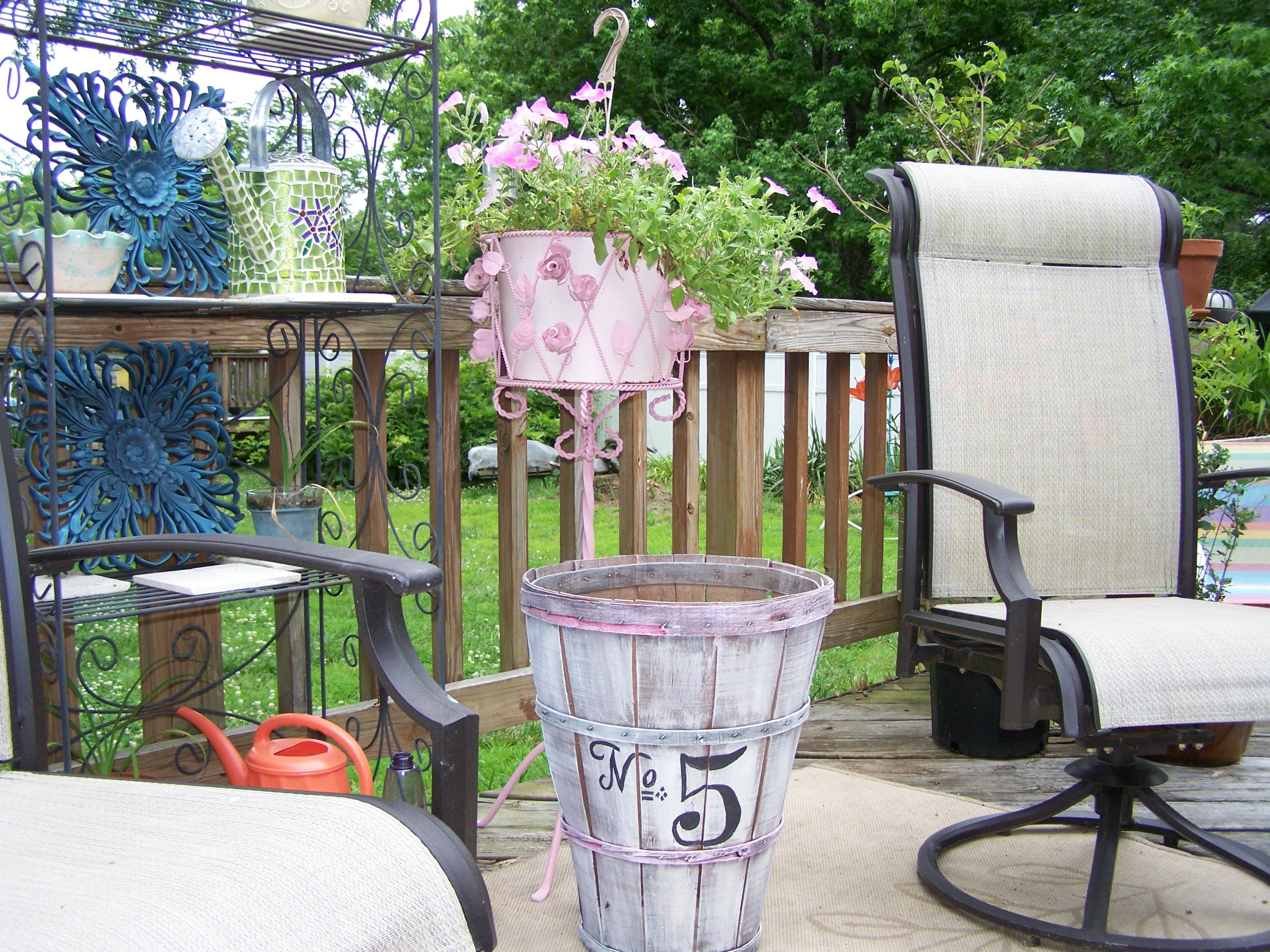Vintage pink plant stand and old painted vegetable basket. Love