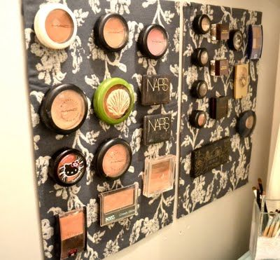 diy makeup storage... printed magnetic board, with little magnets on the bottom of each product..
