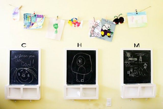 Twine + Clothespins to hang kids' artwork. Cute chalkboards from Ikea.