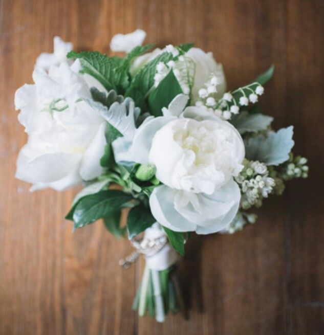 Bouquet of peonies, lily of the valley, gardenia and sweetpeas.   In bloom, ltd.