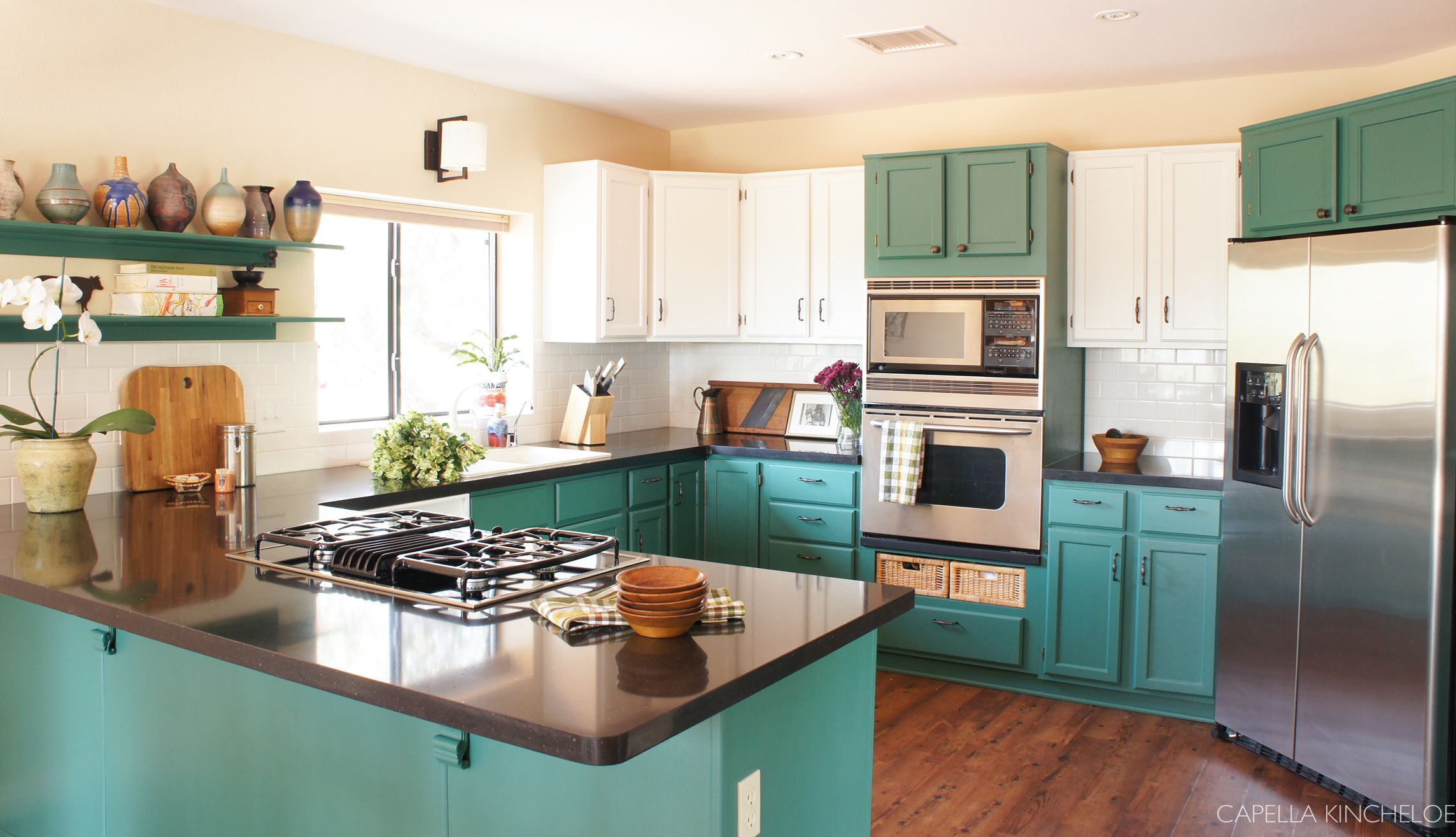 two tone cabinets green kitchen cabinets stainless steel appliances black quartz counters on kitchen remodel appliances id=16661