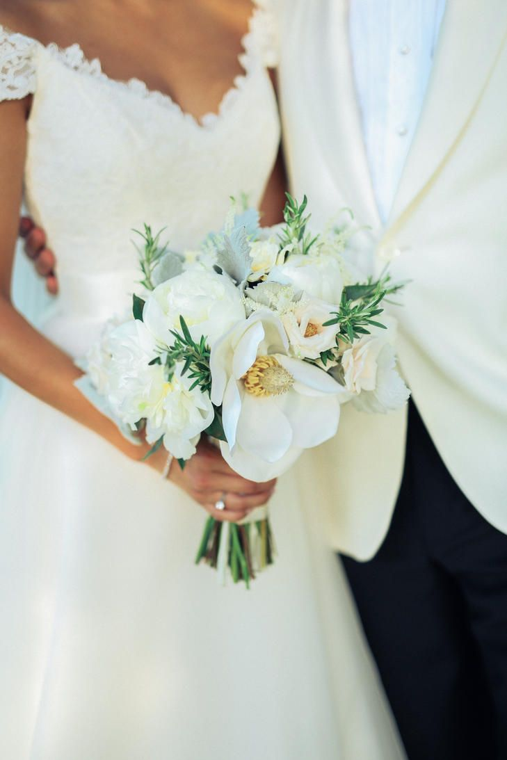 Bouquet included gardenias peonies ranunculus one large magnolia a whimsical plantation wedding at lowndes grove in charleston south carolina izmirmasajfo Choice Image