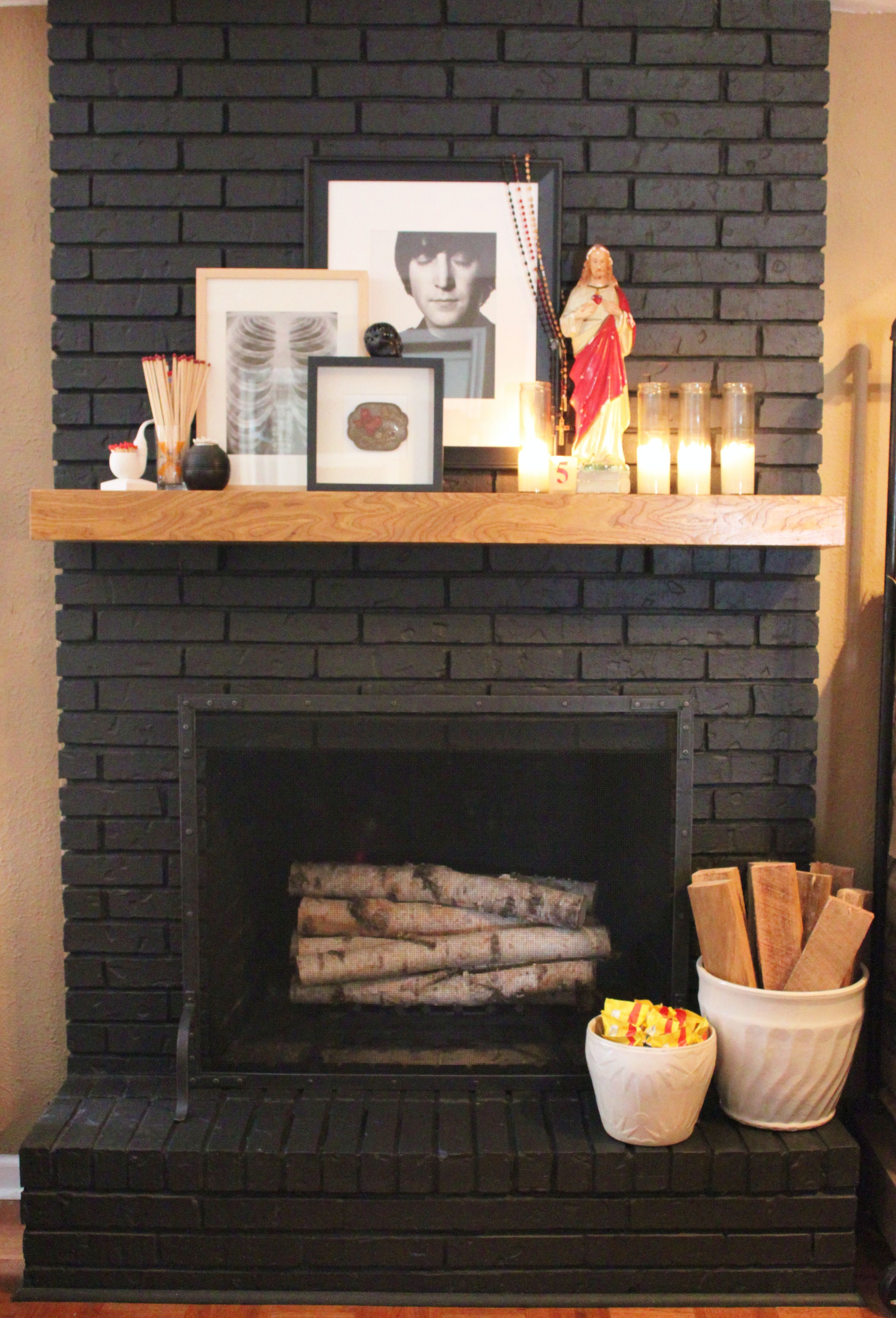 Black painted brick fireplace with new restoration hardware fire