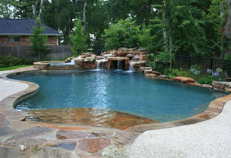 Natural swimming pools natural free form swimming pools for Natural rock swimming pools