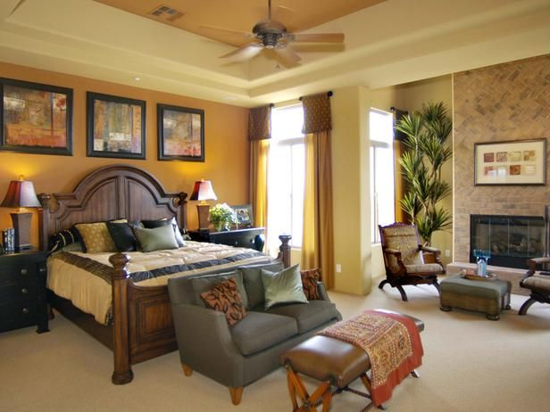 Fireplace Masculine Bedroom The Room 39 S Grand Dimensions Are Accentuated By A Tray Ceiling A