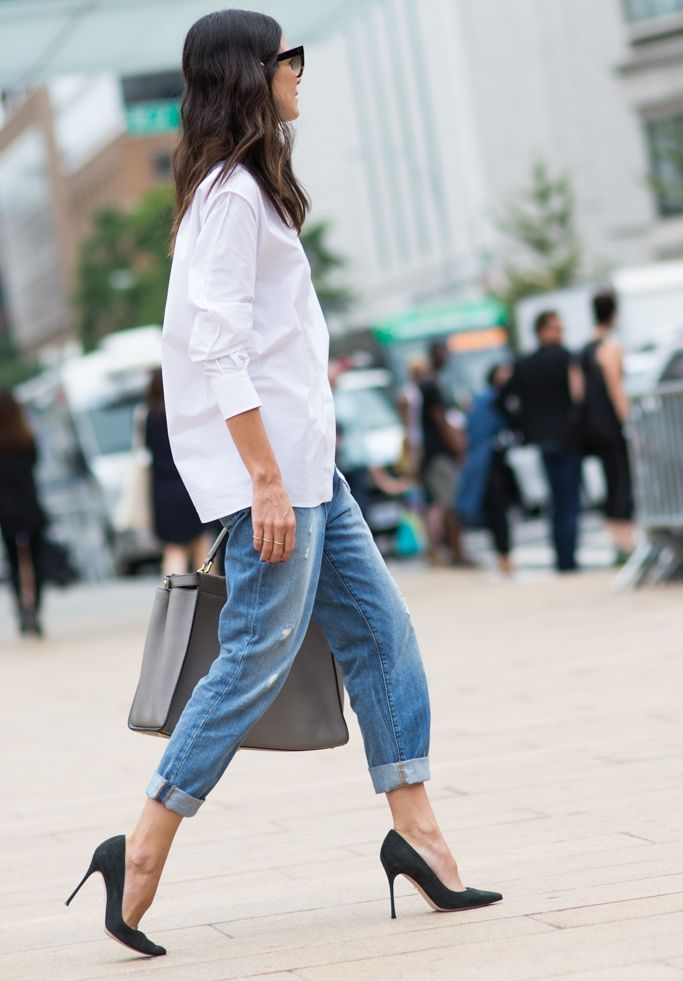 A classic white shirt paired with denim and pumps are a winning combination.