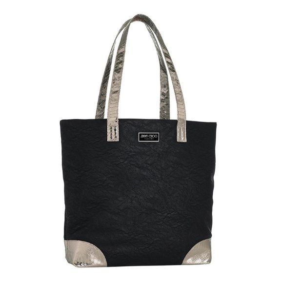 "Jimmy Choo Large Tote Authentic Jimmy Choo tote. A brand new Jimmy Choo Fragrances Limited Edition Tote Bag/Purse. Bag is Black. 2 leather-like drop down handles. Black and Silver metal faceplate on the front has ""JIMMY CHOO PARFUMS"" on it.     Measurements: 15.5""L x 13""H x 5""W and Strap drop is 9""    New without Tag, Made exclusively for Jimmy Choo Parfums. Jimmy Choo Bags Totes"