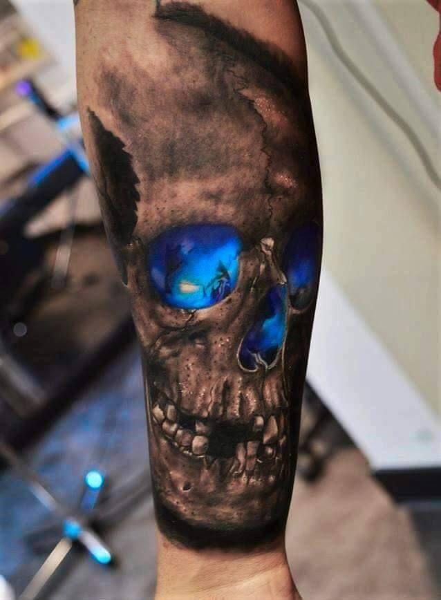 81bccb6cd16f4 Scary Blue Eyes Skull Tattoo On Forearm   Egyptian art   Skull ...