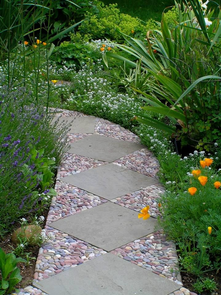 Beautiful contrast of concrete and pebbles path garden for Cement garden paths
