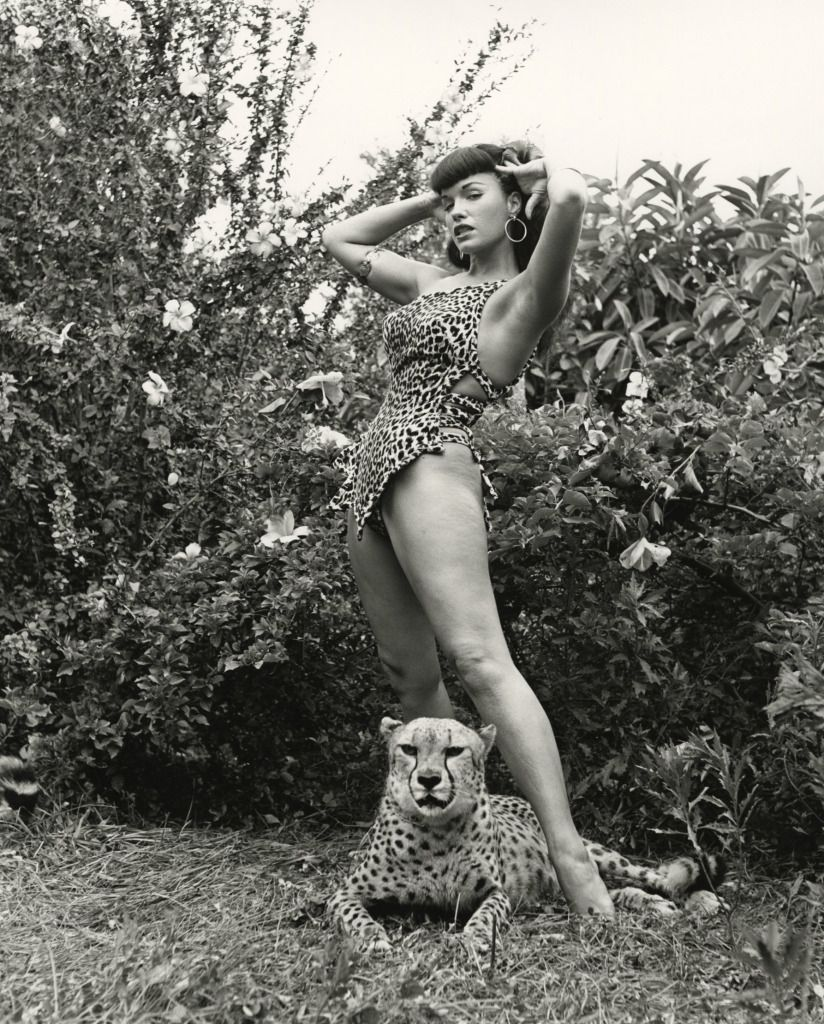 Bunny Yeager - Bettie Page in Leopard-Skin Suit with Cheetah, 1954 | From a unique collection of black and white photography at http://www.1stdibs.com/art/photography/black-white-photography/