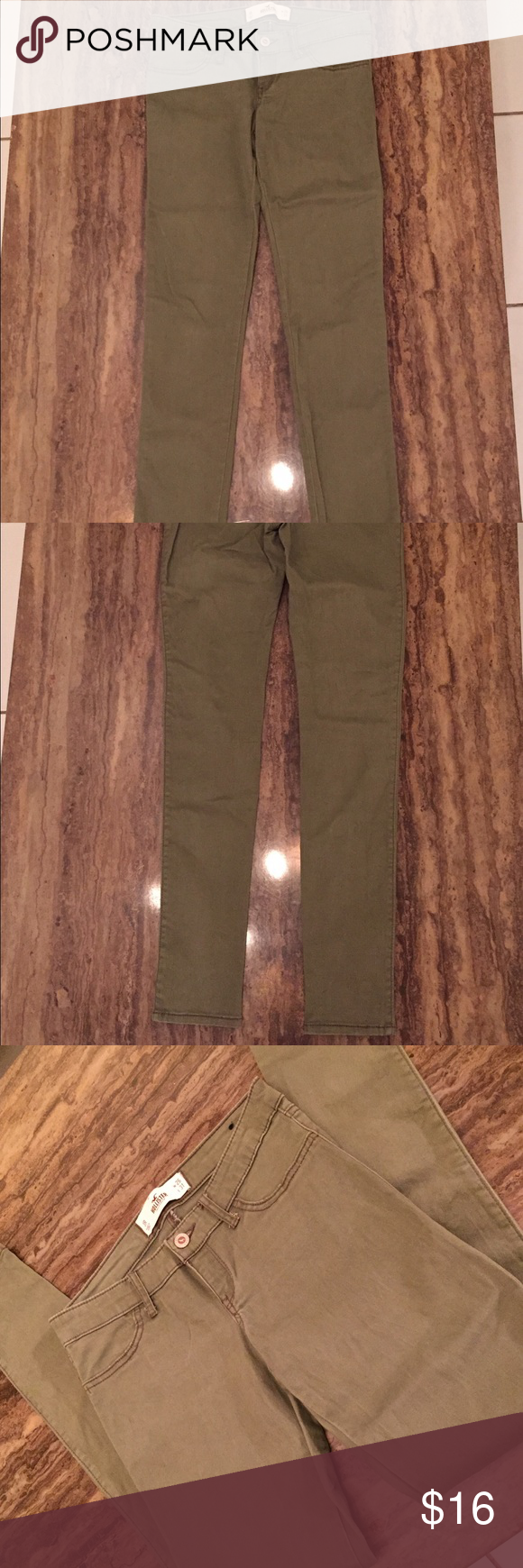 HOLLISTER ARMY GREEN Pants SIZE 3R W26 L 30 1/2 This is a nice pair of Army green skinny Hollister pants in a size 3 R with a 26 waist and 30 1/2 length.  Tag says 31 length but is 30 1/2 inches. The flat waist measures 14 inches rise is 7 inches.  The tag was cut out but they have a spandex blend . Thanks for looking.  See photos for better condition details .  They look great! Hollister Pants Skinny