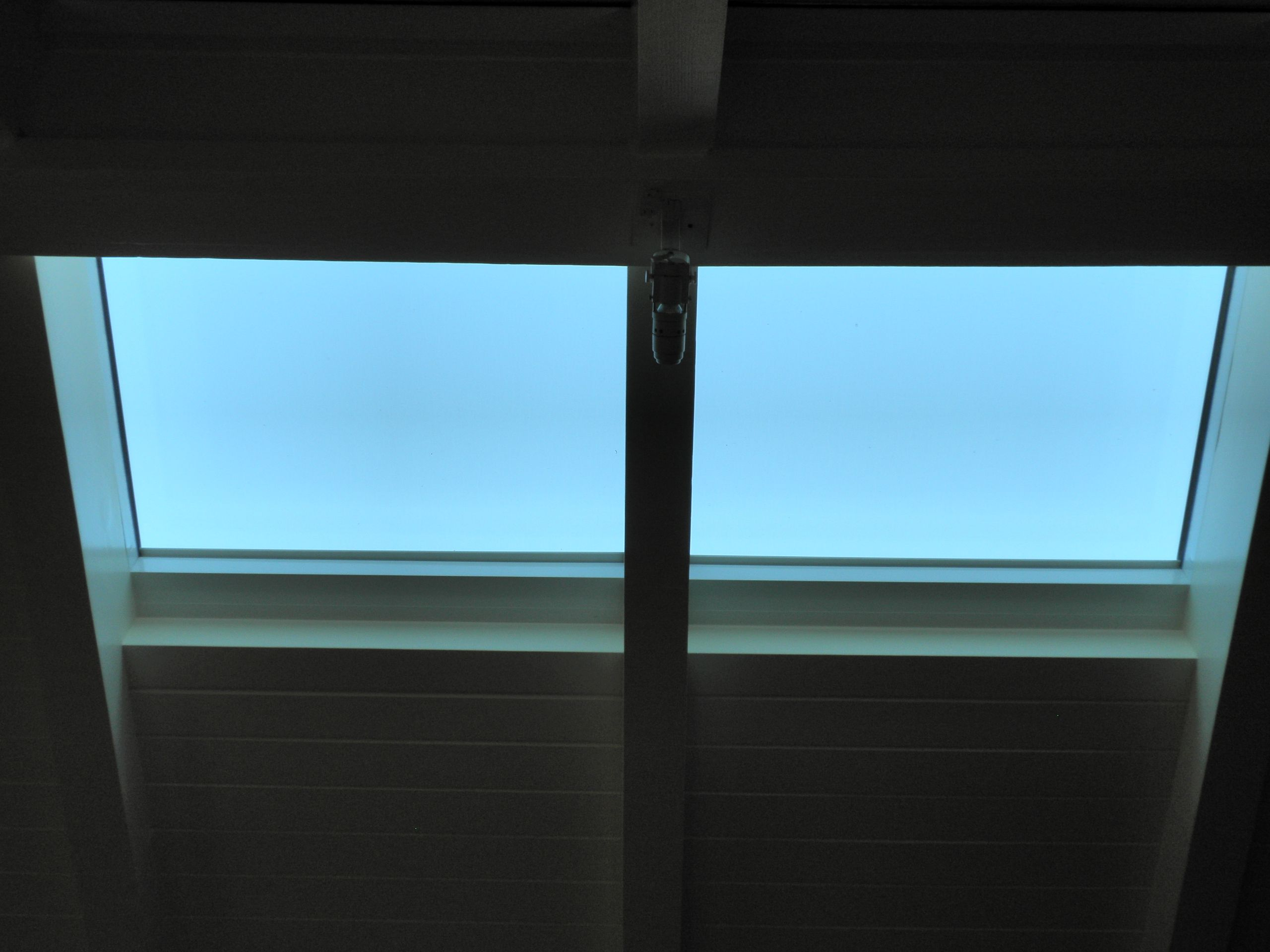 Recessed Lutron QS skylight shade. Note there are 4, 2 on each side ...