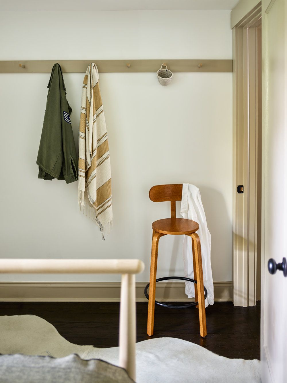 small stool detail + white cowhide rug + hook design