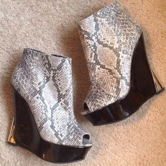 """Patent Leather Faux Snakeskin Peep Toe Booties These are sky high and super hot! Patent leather skinny wedge heel with mirrored metallic cap on heel, faux snakeskin peep toe with side zip. Heel height is 5.5"""" platform is 1 3/4"""". NIB. These would look great with so many things from skirts to Skinnies to cut offs.... ❌NO TRADES❌NO PP❌NO LOWBALLING❌ Liliana Shoes"""