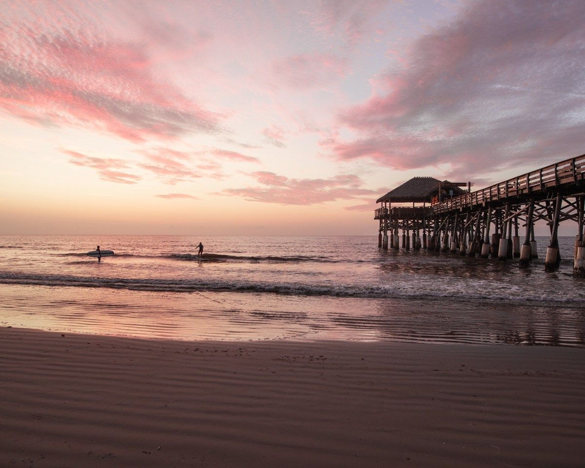 Two Surfers Catch Waves Next To The Westgate Cocoa Beach Pier Find Out More About Cocoa Bea Summer Travel Destinations Cocoa Beach Resort Cool Places To Visit