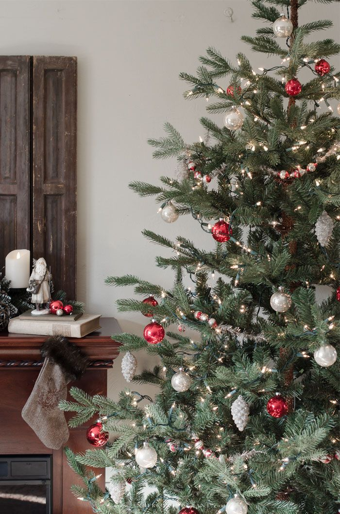 christmas decorating tips and inspiration featuring a rustic mantel and decorated tree wwwandersonandgrantcom sponsored boscovs