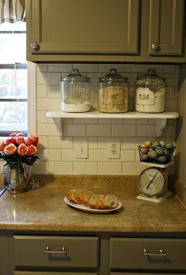 use a small shelf to have things accessible but off the kitchen