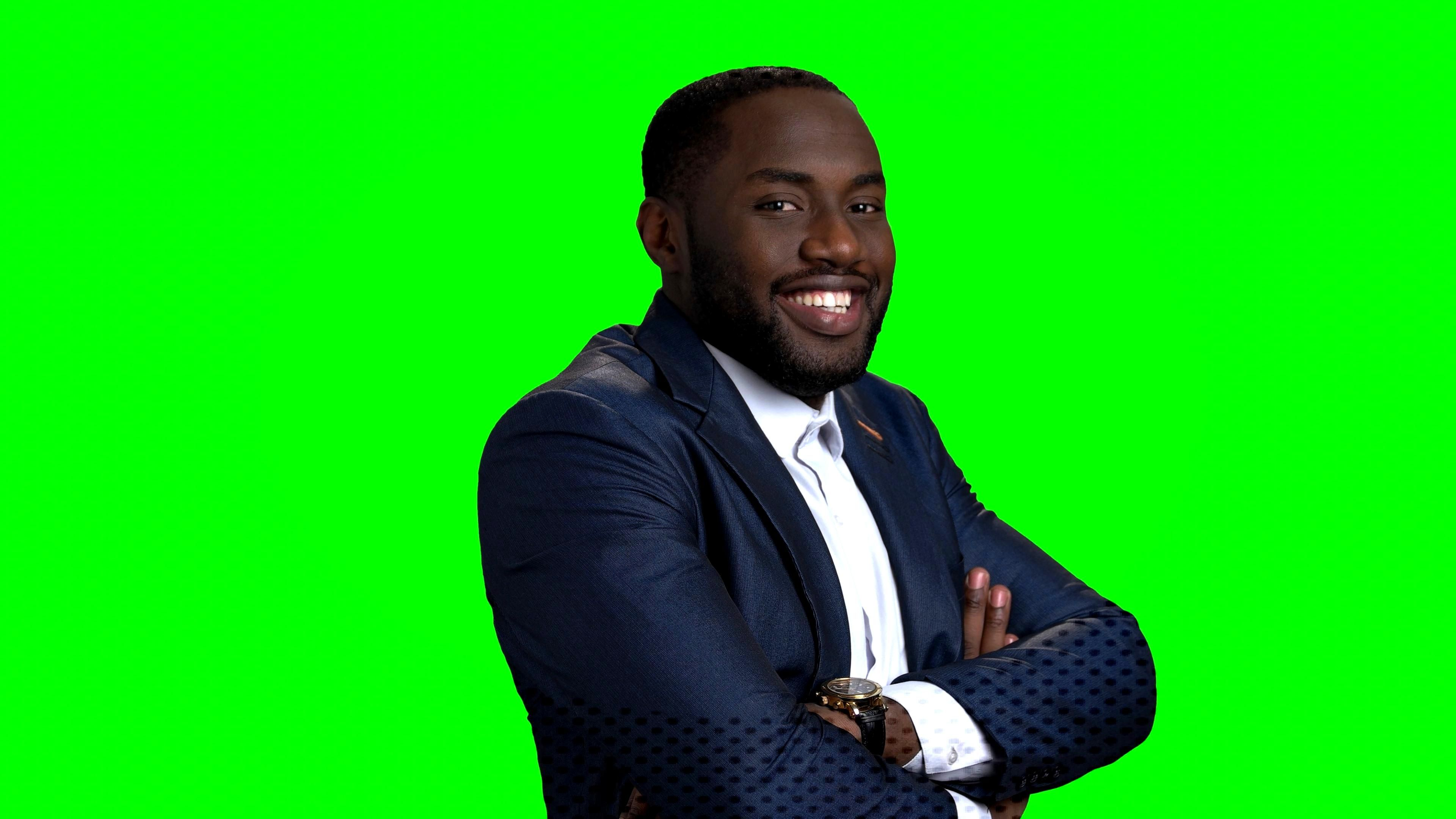 Smiling afro american manager on green screen. Stock Footage ,#american#manager#Smiling#afro