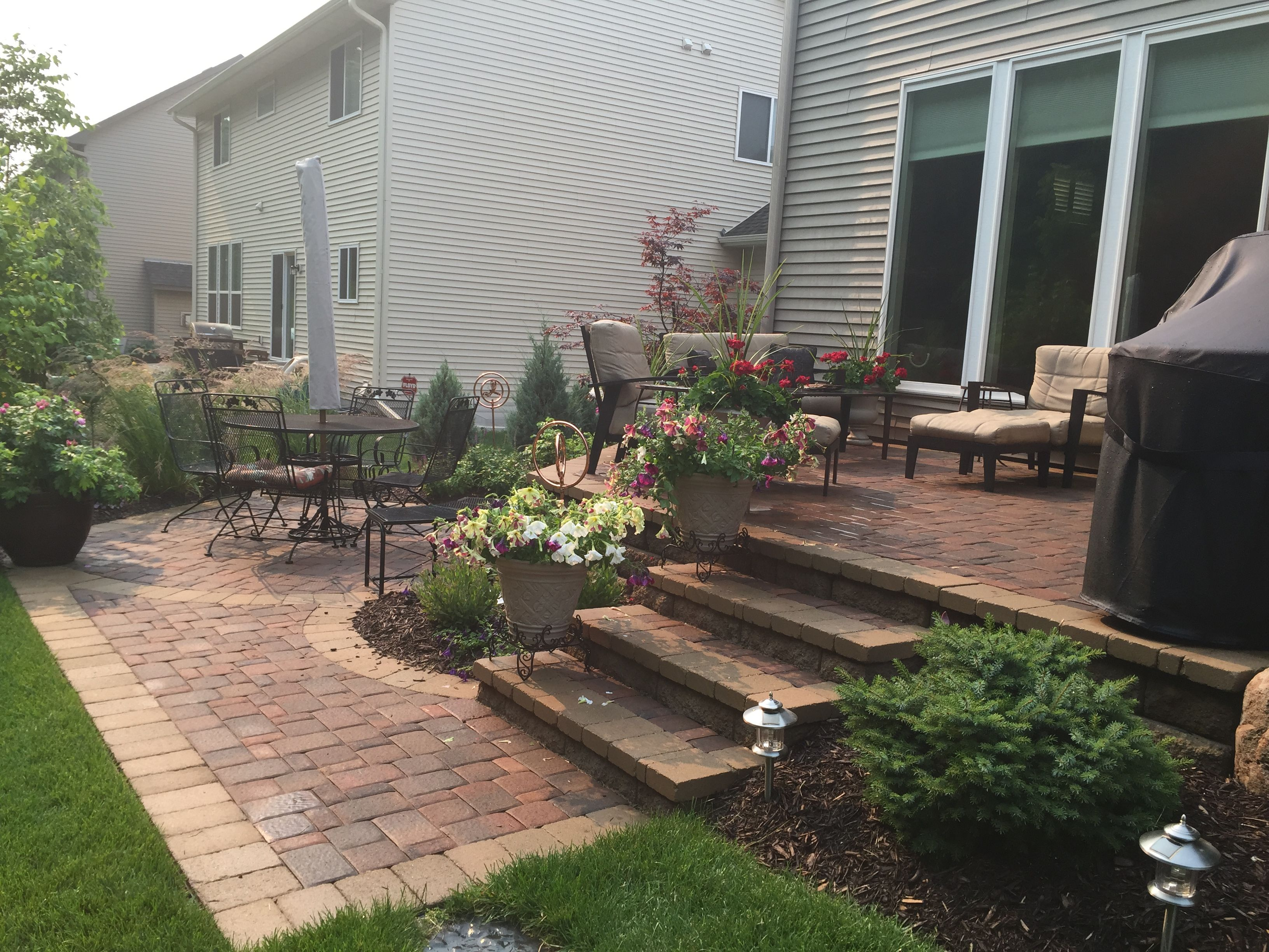 Raised patio ideas - Raised patio with steps down to a second patio space two level patio