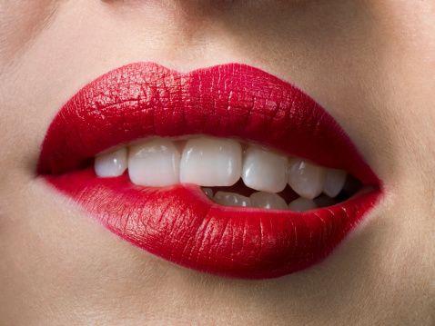 Female With Red Lipstick Biting Lips Close Up Lip Biting