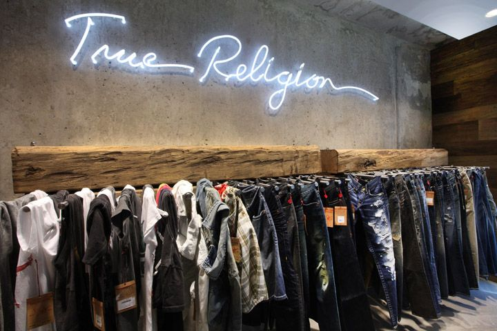 21c88810a True Religion store Berlin - pants and shirts merchandised on dowels ...
